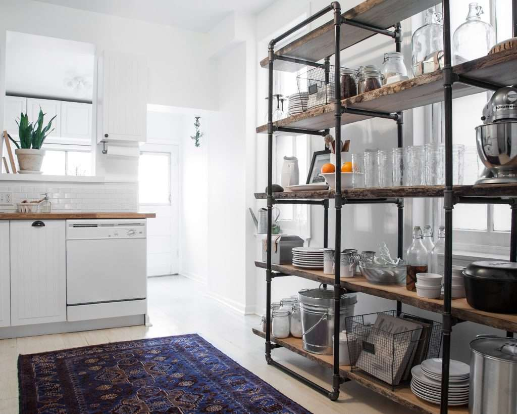 modern white kitchen with gas pipe shelving unit