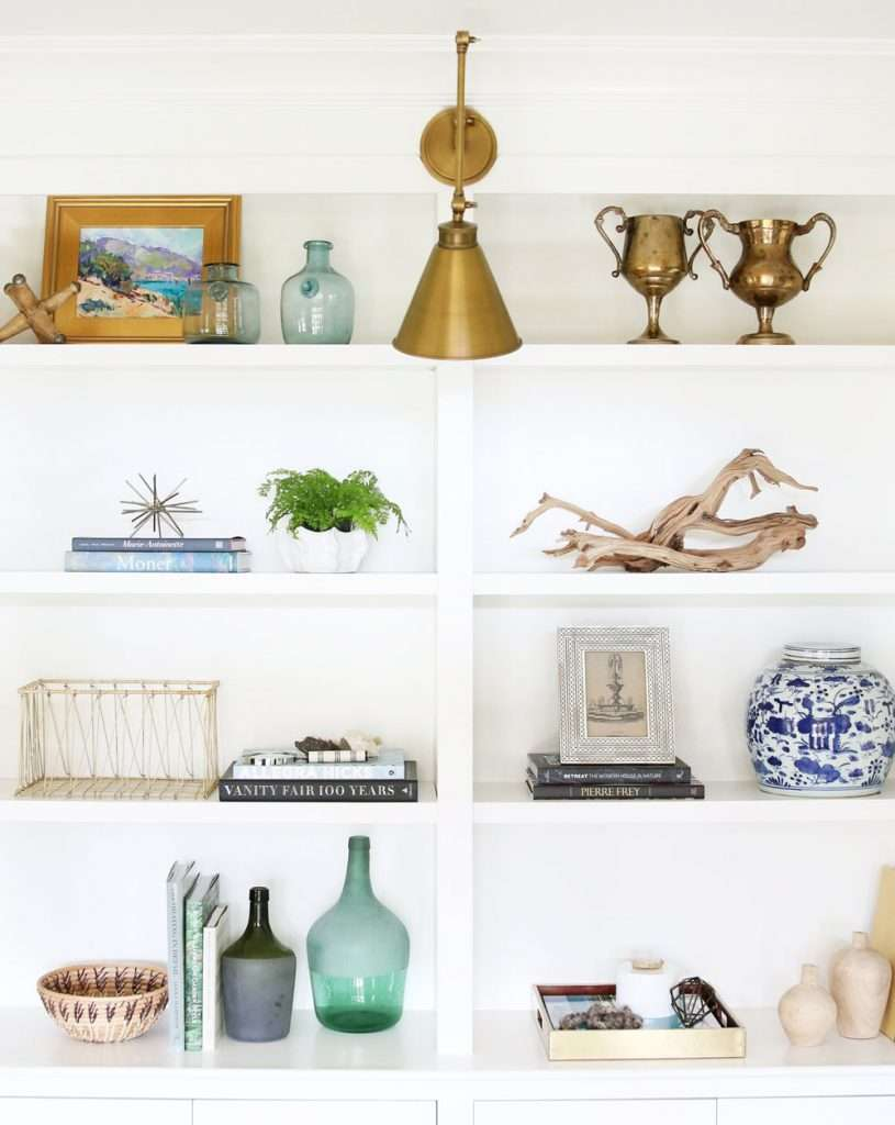 styled bookshelf with clustered groups