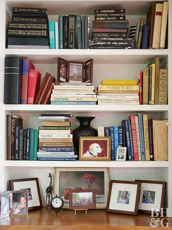 bookshelf with books and artwork