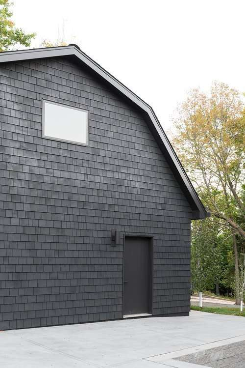 house exterior in benjamin moore french beret black paint