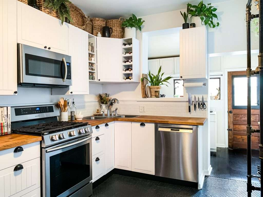 kitchen with subway tile and butcher block countertops