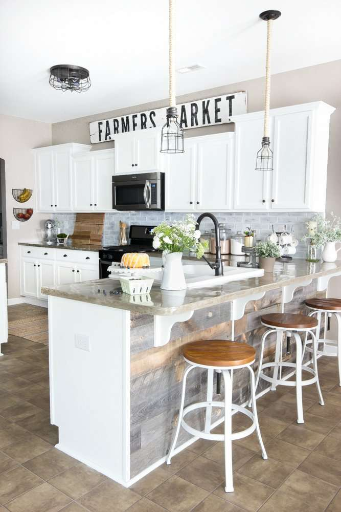 farmhouse kitchen with farmers market sign above cabinets