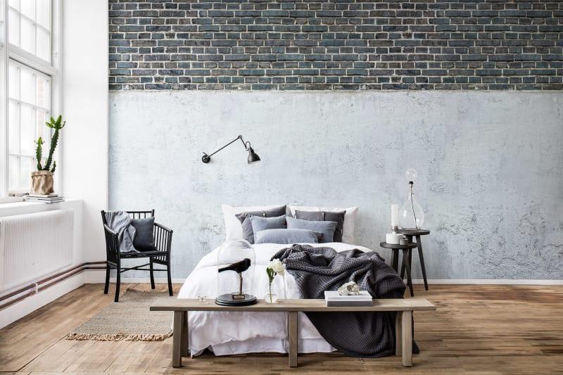 brick and plaster wallpaper mural in bedroom