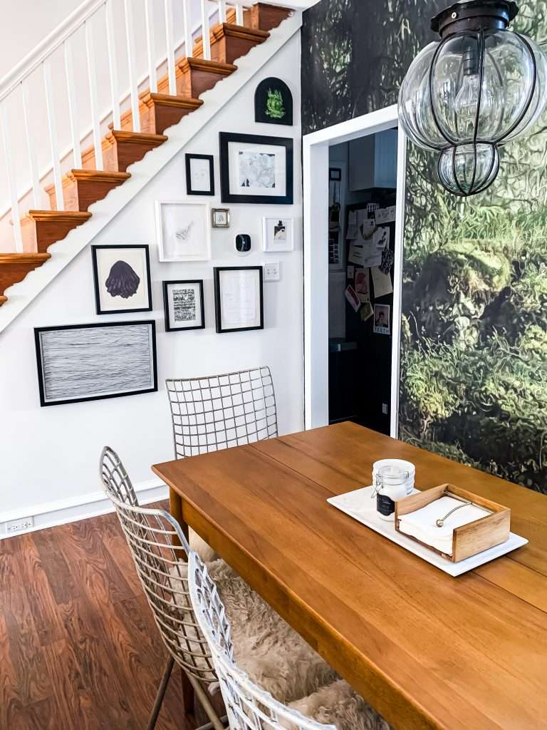 dining area with forest wallpaper and gallery wall