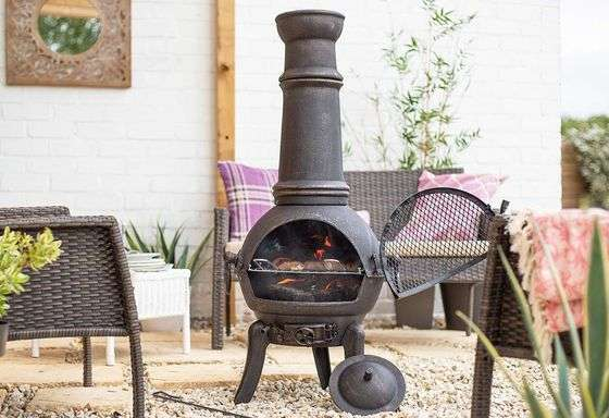cast iron chiminea in a backyard