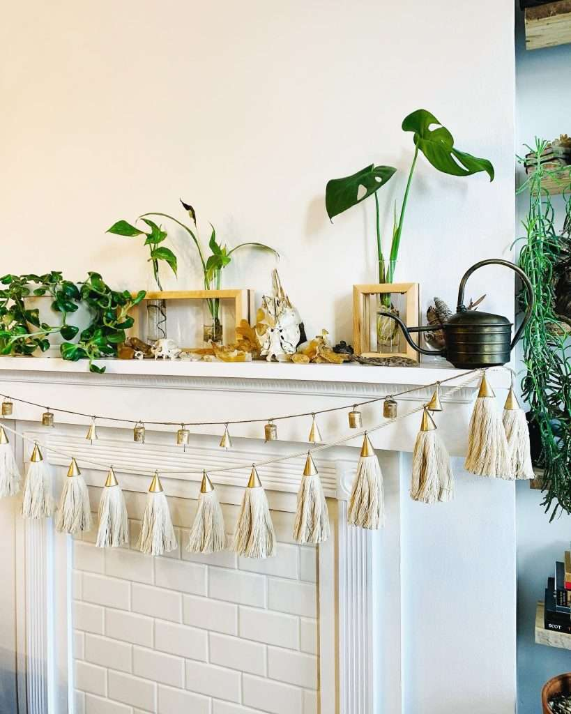 modern mantel with bell and tassel garland
