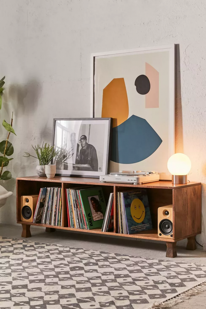 Low credenza with vinyl records and speakers
