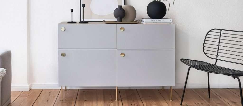 Ikea Besta cabinet with slim brass legs and custom drawer pulls